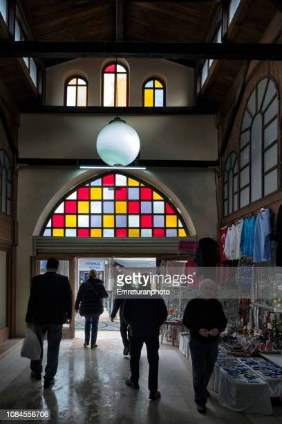 colorful windows of a shopping mall entrance - emreturanphoto stock pictures, royalty-free photos & images