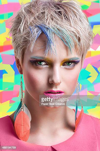 Colorful woman with hair dye on her eyebrows