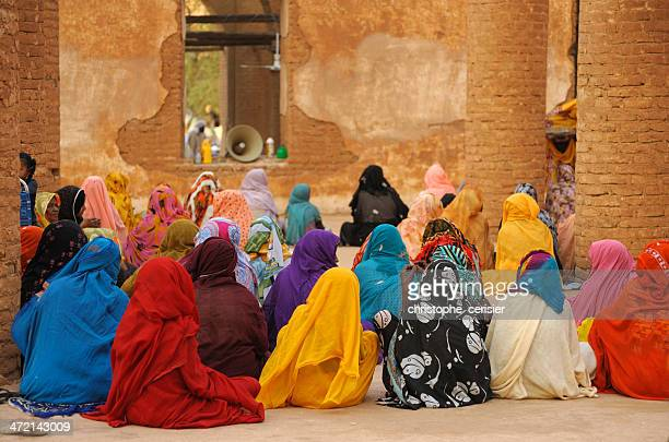 colorful women during prayer in mosque, kassala, sudan - sudan stock pictures, royalty-free photos & images