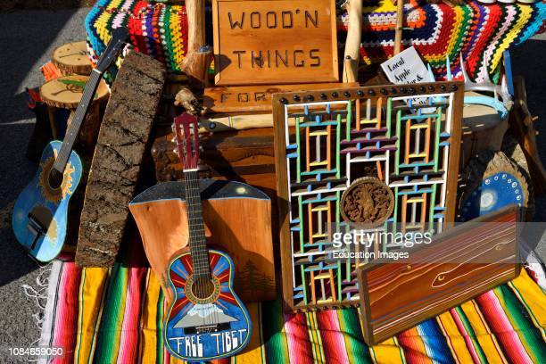 Colorful wooden art objects at a craft fair of the Wellington Farmers Market Prince Edward County Ontario Canada.