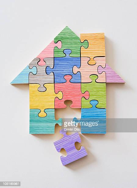 Colorful wooden house shaped puzzle pieces