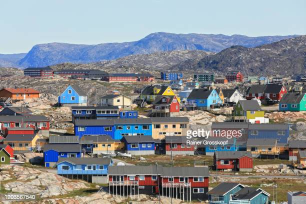 colorful wooden houses in a mountaineous nordic region - rainer grosskopf stock pictures, royalty-free photos & images