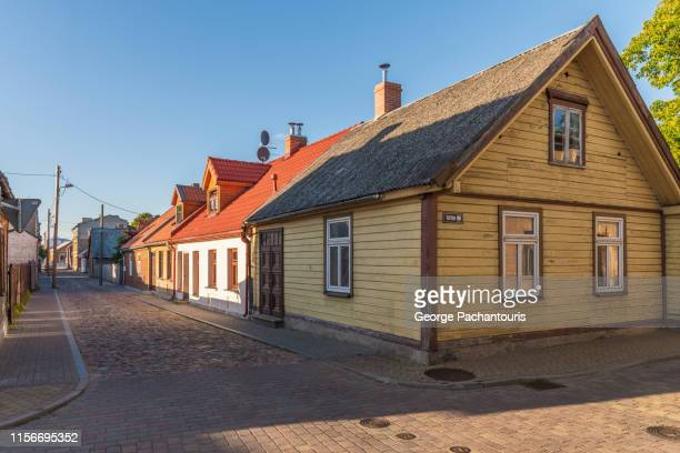 colorful wooden houses in ventspils, latvia - lettland stock-fotos und bilder
