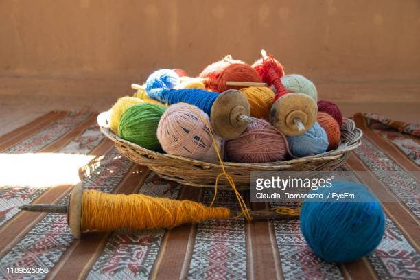 colorful wool in basket on table - claudia romanazzo foto e immagini stock