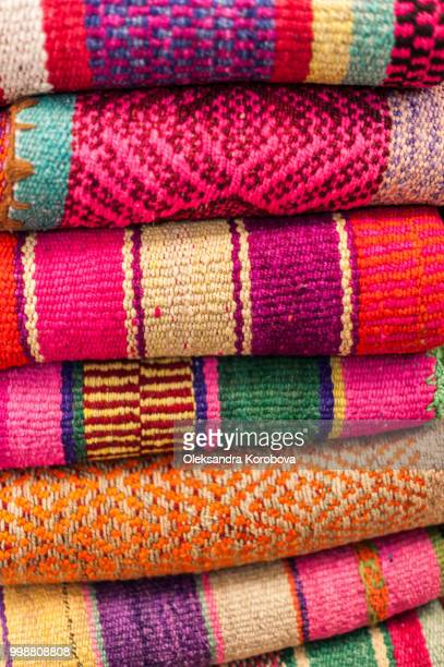 colorful woven peruvian textiles with traditional patterns at a market in south america. - lima animal stock pictures, royalty-free photos & images