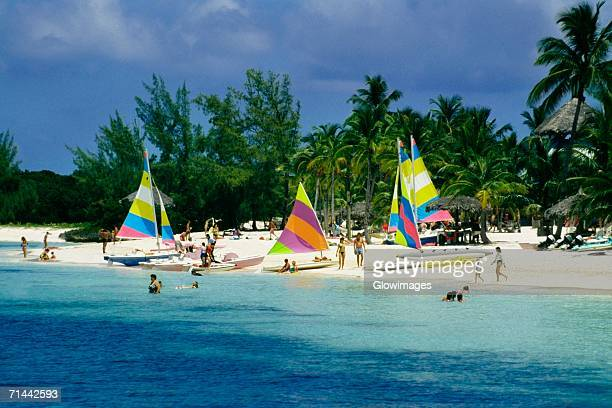 colorful yachts seen on a seashore, treasure island, abaco, bahamas - abaco islands stock photos and pictures