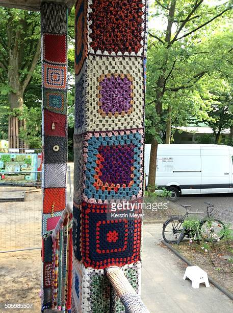 colorful yarn bombed pillars of a building