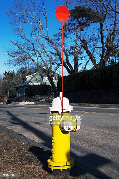 Colorful yellow fire hydrant and red flag in Marblehead Massachusetts