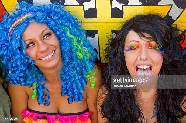 Colorful young women in rave fashion outfits at street party during the Gay Pride Festival. Other keywords: revelers, ravers, women, partying, having...