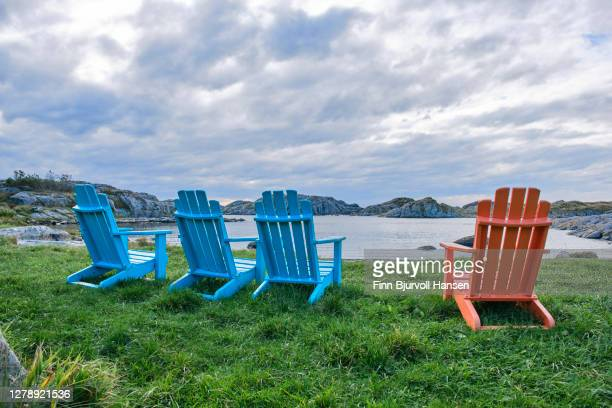 colorfull chairs at syre beach near skudenehavn in karmoy norway - finn bjurvoll stock pictures, royalty-free photos & images
