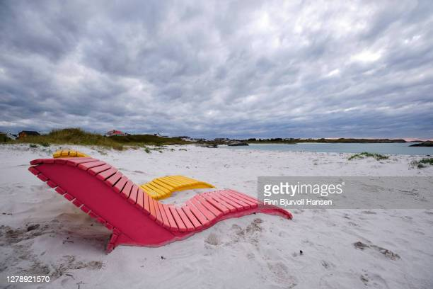 colorfull chairs at the beach of åkrasanden at karmoy norway - finn bjurvoll stock-fotos und bilder
