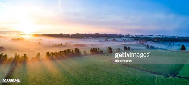 colorfull sunrise on foggy day over tipperary mountains and fields - grand horizons stock pictures, royalty-free photos & images