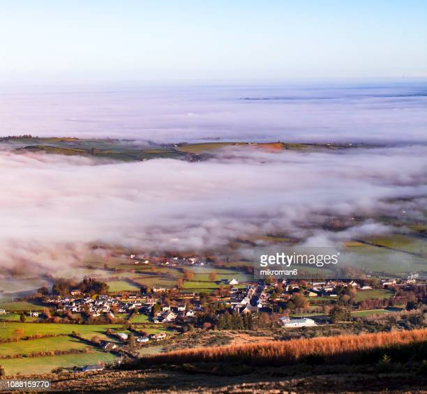 colorfull sunrise on foggy, winter day over tipperary mountains and fields. ireland - ティッペラリー州 ストックフォトと画像