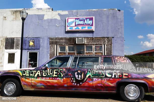 A colorfully decorated car outside Delta Blues Alley Cafe on Delta Avenue in Clarksdale Mississippi on September 27 2017 This city is set to receive...