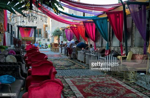 colorfully decorated sidewalk cafe in alacati. - emreturanphoto stock pictures, royalty-free photos & images