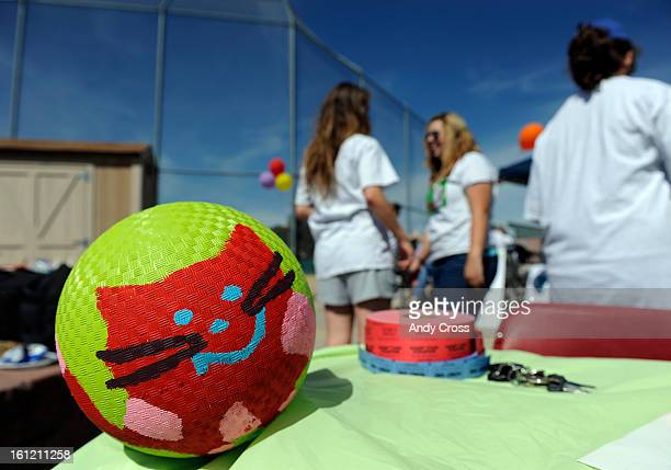 DENVER CO Colorfully painted kick balls were on hand at the 3rd annual McKaila Ball a kickball party at the Colorado Rockies Fastpitch Softball Field...