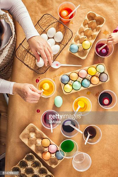 coloring easter eggs with natural dye - dye stock pictures, royalty-free photos & images