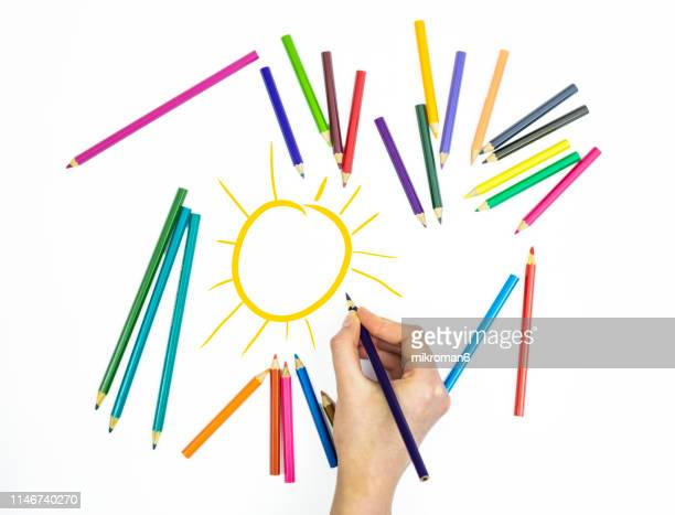 coloring pencils on white page with sun - craft stock pictures, royalty-free photos & images