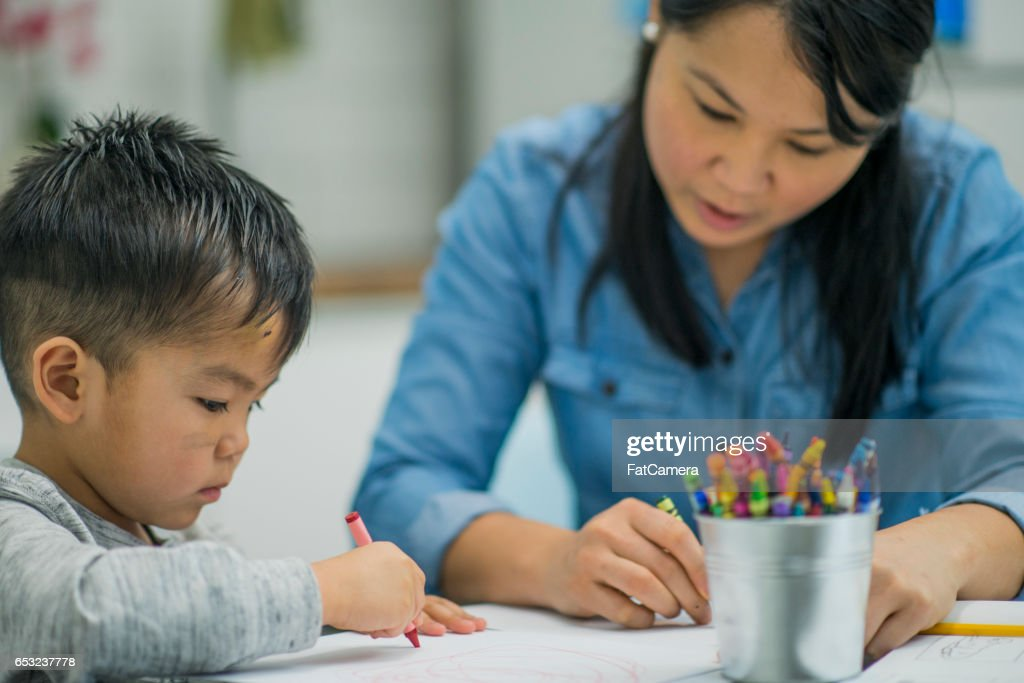 Coloring Together at Home : Stock Photo