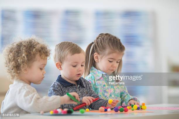 coloring together in class - toy animal stock photos and pictures