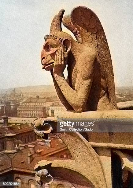 Colorized close up of a leering gargoyle from the Cathedral of NotreDame Paris France 1922