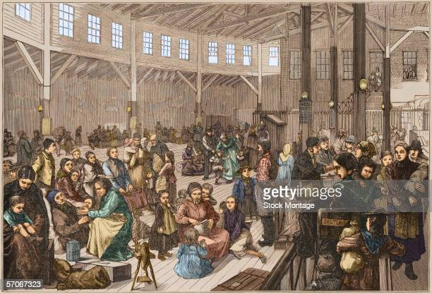 Colorized engraving shows a large number of European Mormon immigrants gathered in Emigrant Landing Depot at Battery Park New York New York 1878