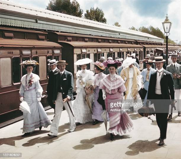 Colorized photo of fashionably-dressed travelers at the train station, Henley-On-Thames, England, 1897. They were there to attend the Royal Regatta.