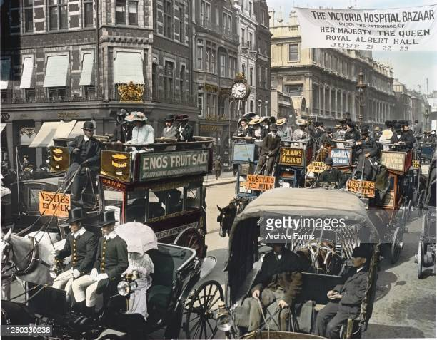 Colorized photo of traffic on a busy street, London, England, 1897. Among the visible vehicles are horse-drawn omnibuses, hansoms, private broughams,...