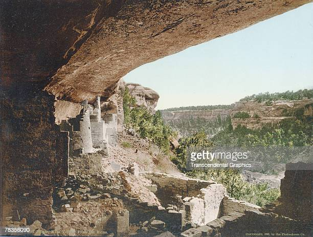 Colorized photograph of the Cliff Palace, a sandstone structure built into an alcove in a cliff, Mesa Verde, Colorado, 1898. Built in the late 1100s,...