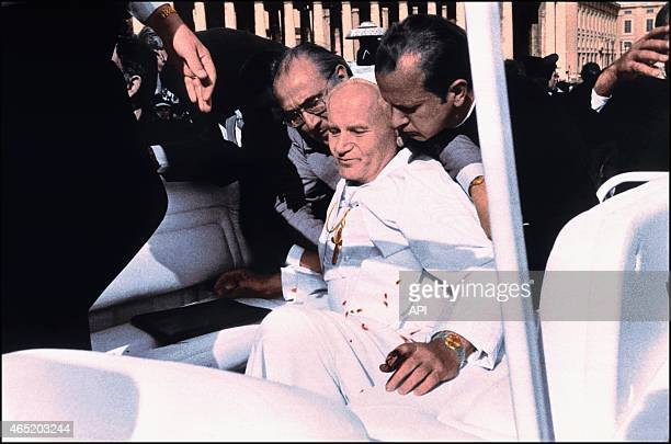 Colorized picture of the terrorist attack against John Paul II when Turk Mehmed Ali Agca fires three bullets at the pope from close range wounding...