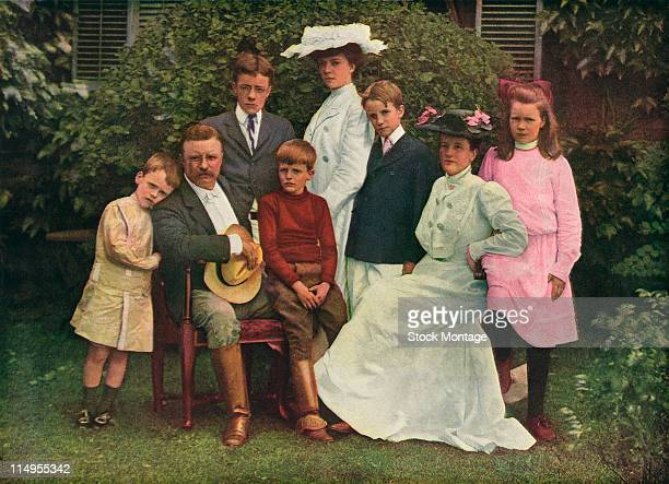 Colorized portrait of American President Theodore Roosevelt and his family as they pose outside Oyster Bay New York 1903 Pictured are from left son...