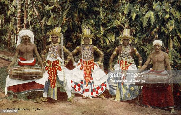 Colorized postcard depicts a group of socalled 'Devil Dancers' in Ceylon early twentieth century