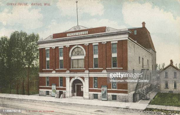 Colorized postcard of an elevated view of the exterior of the opera house Antigo Wisconsin 1909