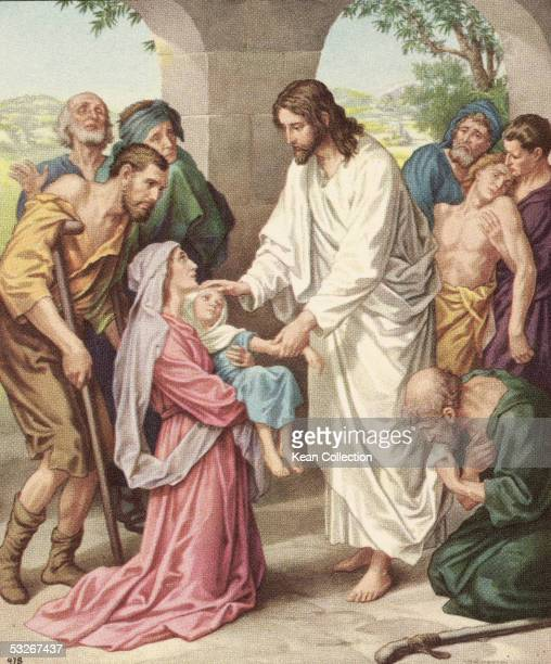 Colorized print shows Jesus as he heals a sick child held in the arms of a woman as others in varying degrees of distress await their turn The...