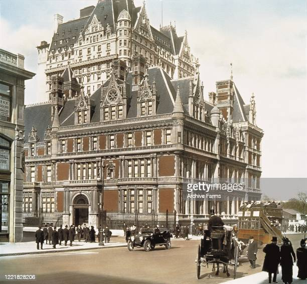 Colorized view, looking north across the intersection of 5th Avenue and 57th Street, of the Cornelius Vanderbilt II House, New York, New York, May...