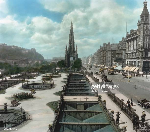 Colorized view, looking west along Princes Street, towards the Scott Monument, Edinburgh, Scotland, 1914. At fore is the roof of the Waverly Market...