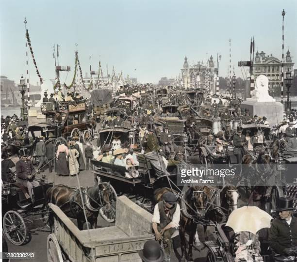 Colorized view of traffic on Westminster Bridge as pedestrians weave through the paths of various horse-drawn vehicles, London, England, 1897.
