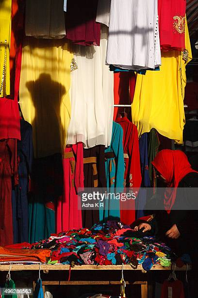 CONTENT] colors dresses street egypt cairo attaba egyptian women hijab gallabeya for sale shadow colorful street market street cart display veiled...