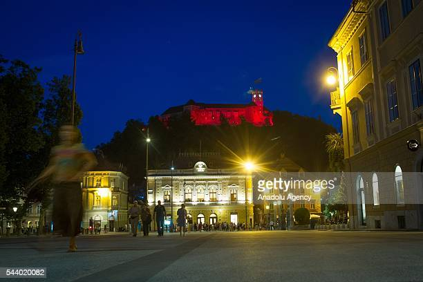 Colors of the Turkish flag are projected on historical Ljubljana castle following the recent terror attack at Istanbul Ataturk Airport on June 30...