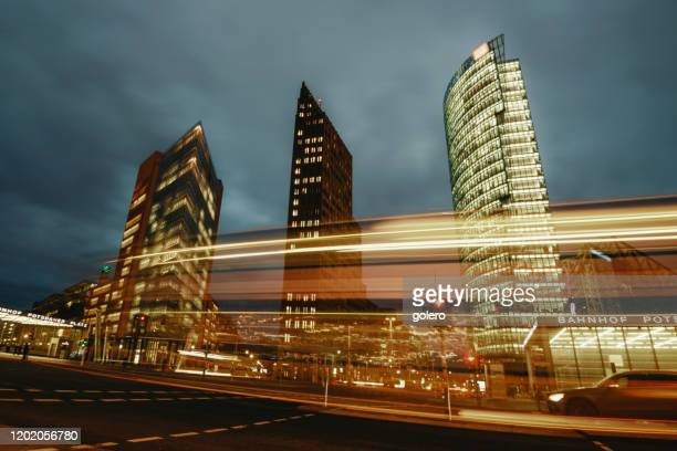 colors of traffic on potsdamer platz in berlin at evening hour - sony center berlin stock pictures, royalty-free photos & images