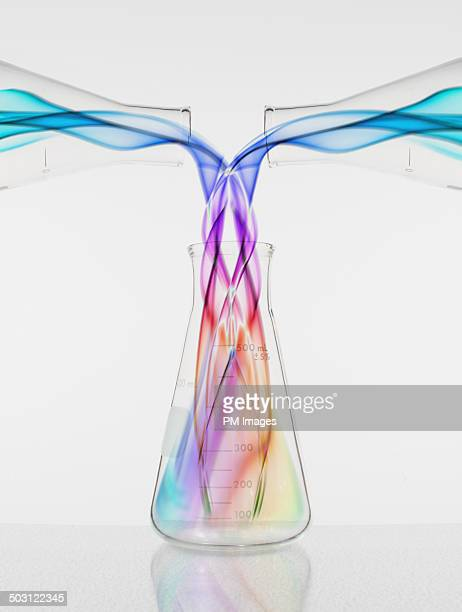 colors pouring into beaker - chemistry stock pictures, royalty-free photos & images