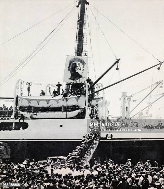 A colossal portrait of Benito Mussolini set up in a troopship departing to East Africa Naples Italy photograph from The Illustrated London News...