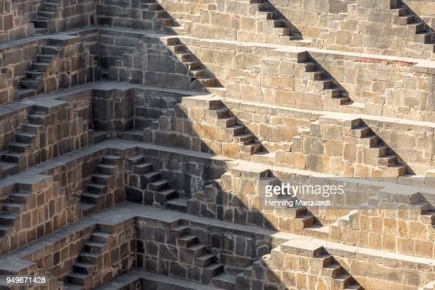 colossal stepped water tank, detail of stairs, abhaneri, rajasthan, india - abhaneri stock photos and pictures