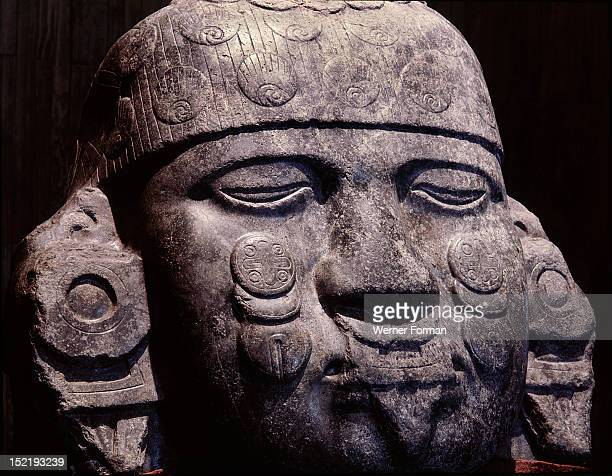 Colossal stone head of Coyolxauhqui the Moon Goddess who was beheaded by her brother the Sun She has bells on her cheeks and wears a moon shaped nose...