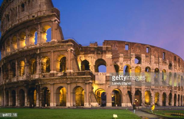 colosseum at night. - coliseum rome stock photos and pictures