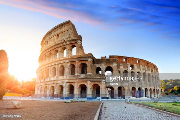 colosseum at sunrise, rome - colosseum stock pictures, royalty-free photos & images