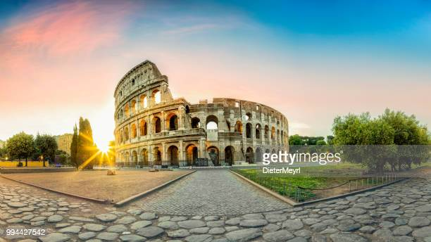 colosseum in rome and morning sun, italy - rome italy stock pictures, royalty-free photos & images