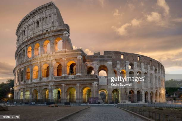 colosseum in rome at sunrise - colosseum stock pictures, royalty-free photos & images