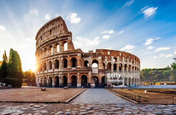 colosseum in rome during sunrise - rome italy stock pictures, royalty-free photos & images