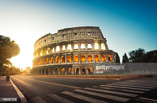 colosseum in rome, italy at sunrise - roma stock photos and pictures